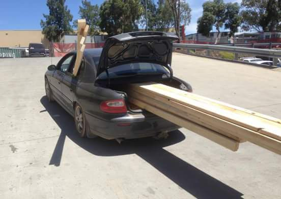 Car with lumber in trunk