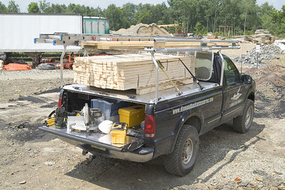 Truck with DiamondBack Truck Bed Cover, loaded with Lumber. Image Credit: DiamondBack Truck Covers