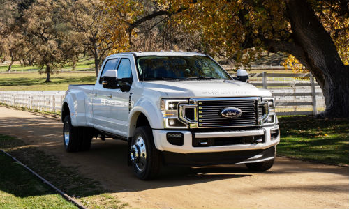 2020 Ford F Series White parked on Country Road