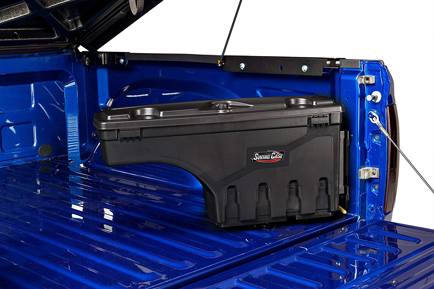 SwingCase installed over the wheel of a blue truck